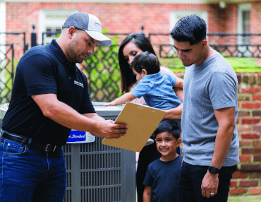 service repairs tech with family